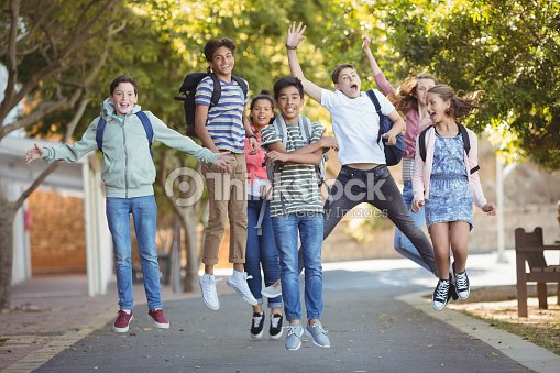 Smiling school kids having fun on road in campus : Stock Photo