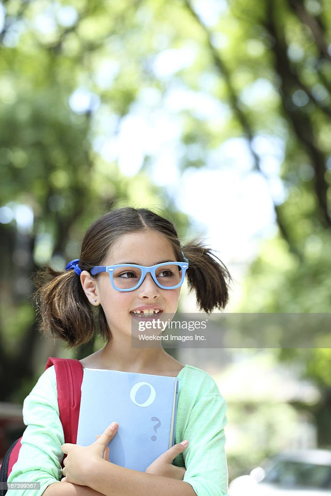 Smiling schoolgirl : Stock Photo
