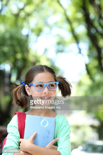 Smiling schoolgirl : Stock Photo