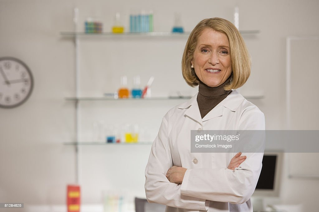 Smiling scientist in lab : Stock Photo