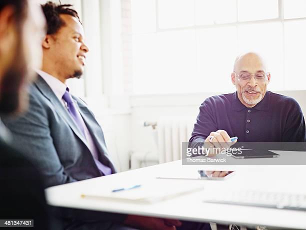 Smiling senior businessman leading discussion