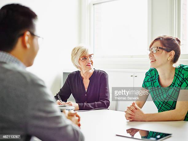 Smiling senior businesswoman leading discussion