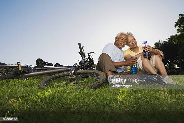 Smiling senior couple with mountain bike