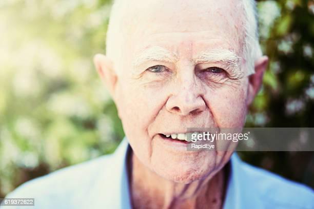 Smiling senior in the sunshine