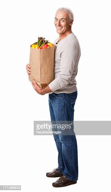 Smiling Senior Man Holding a Bag Of Groceries - Isolated