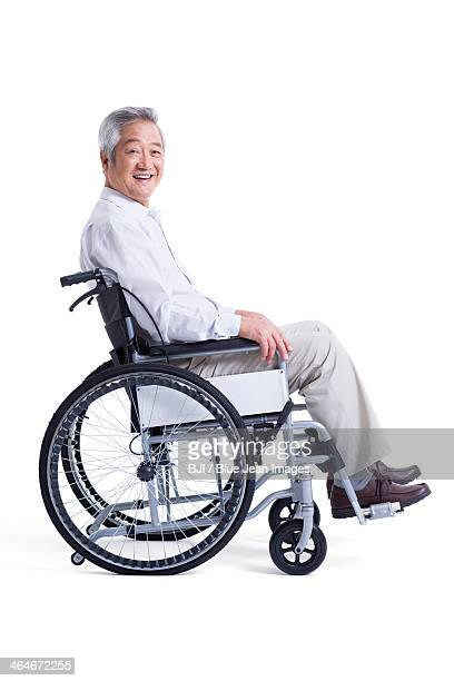 Smiling senior man in wheelchair