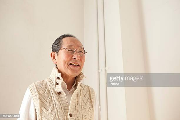 Smiling senior man looking away