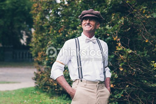 senior souriant mode vintage homme appr ciant son jardin photo thinkstock. Black Bedroom Furniture Sets. Home Design Ideas