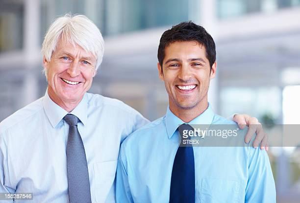 Smiling senior with junior executive