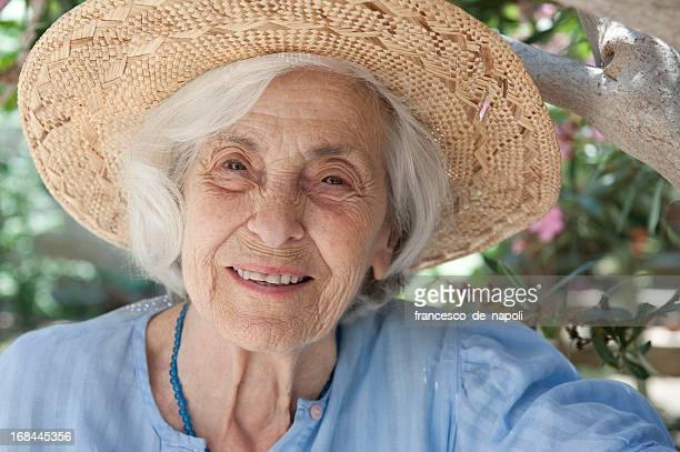 Smiling senior woman and straw hat