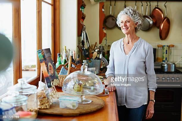 Smiling senior woman at kitchen counter