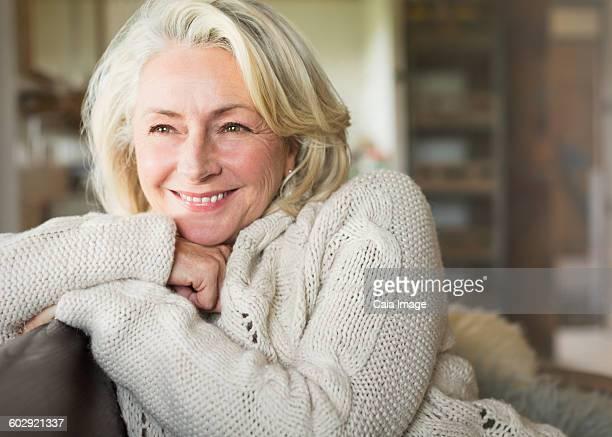 Smiling senior woman in sweater looking away