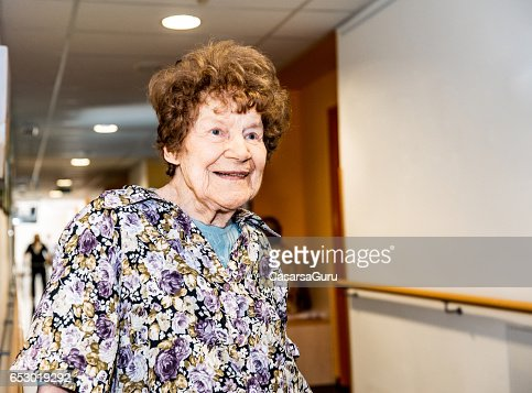 Smiling Senior Woman In The Retirement Home Waiting In The Corridor : Stock-Foto