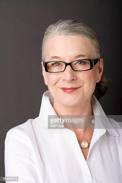 Smiling senior woman posing in studio, portrait
