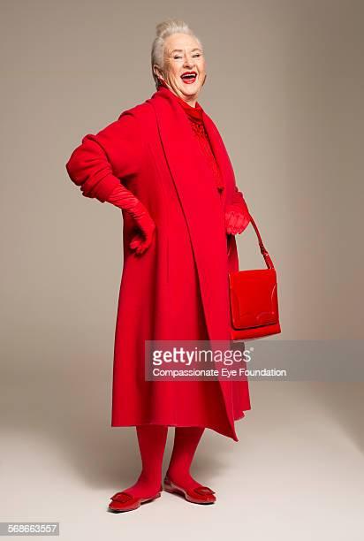 Smiling senior woman wearing red coat