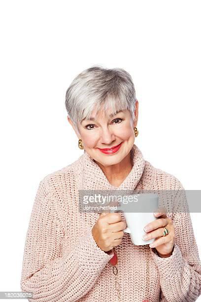 Sonriente mujer Senior con una taza de café