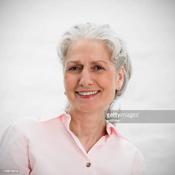 A smiling senior woman with gray hair