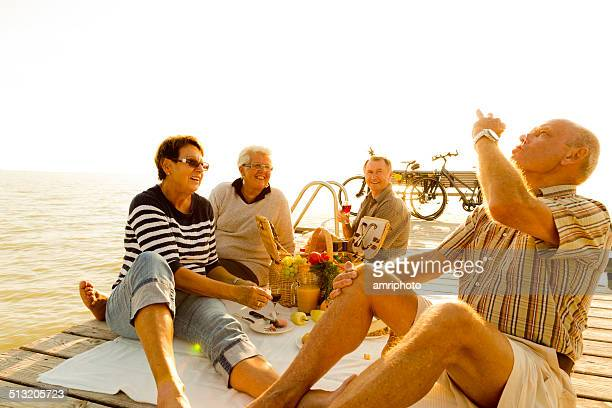 smiling seniors enjoying picnic