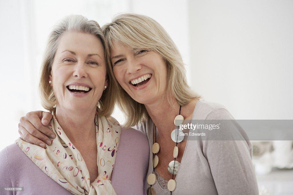 Smiling sisters hugging