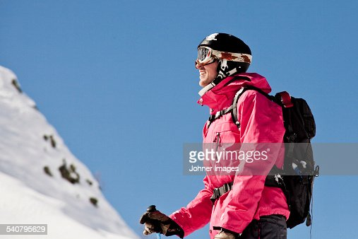 Smiling skier looking up