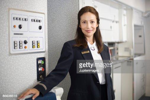 Smiling stewardess on airplane