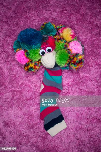 Smiling Striped Sock Puppet with Googly Eyes and Pom-pom Hair