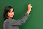 smiling student at blackboard