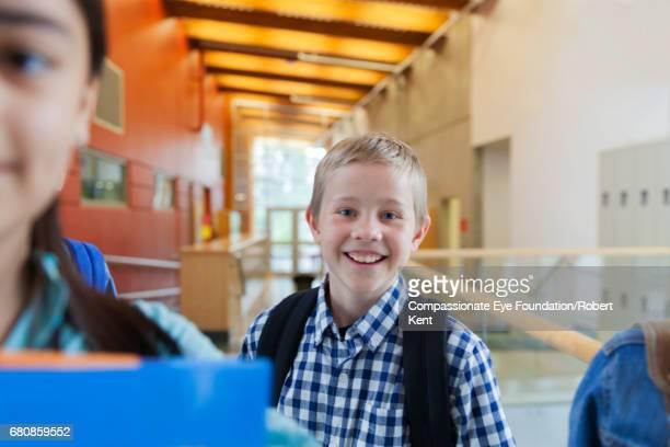 Smiling student in corridor