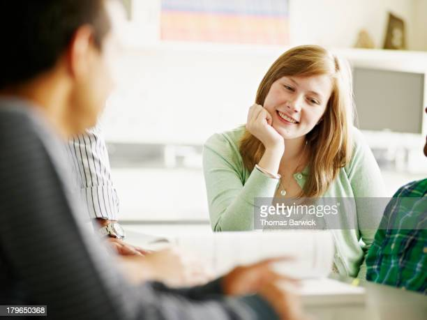 Smiling student in discussion in lab classroom