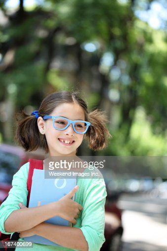 Smiling student with a textbook : Stockfoto