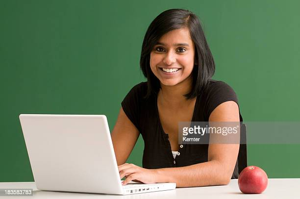 smiling student with laptop