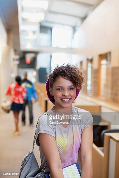 Smiling students standing in hallway