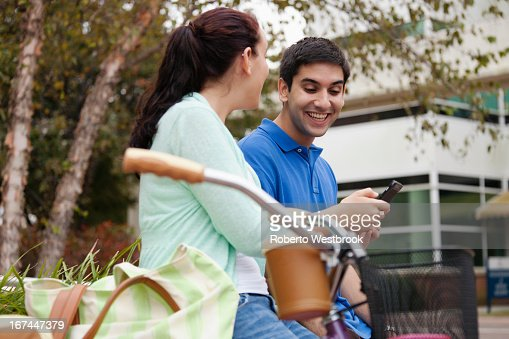 Smiling students talking on campus : Stock Photo