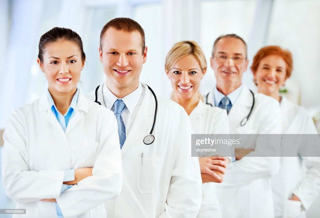 Smiling successful team of doctors : Stock Photo