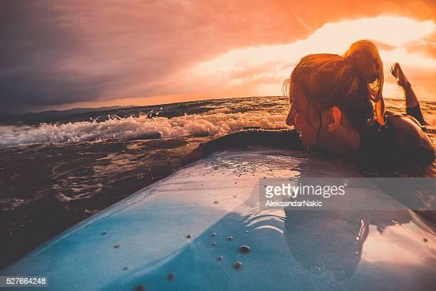 Smiling surfer girl