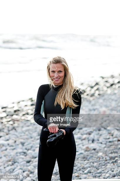 Smiling surfer on beach