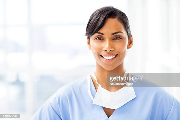 Smiling Surgeon With Surgical Mask In Hospital