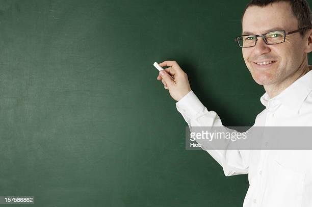 smiling teacher at the blackboard