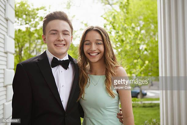 Smiling teenage couple dressed up for prom