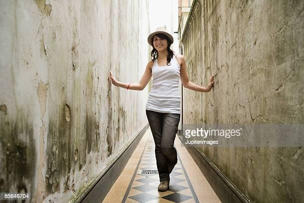 Smiling teenage girl in corridor