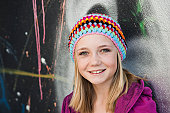Smiling teenage girl wearing beanie, portrait