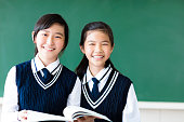 smiling  teenager student girls in  classroom