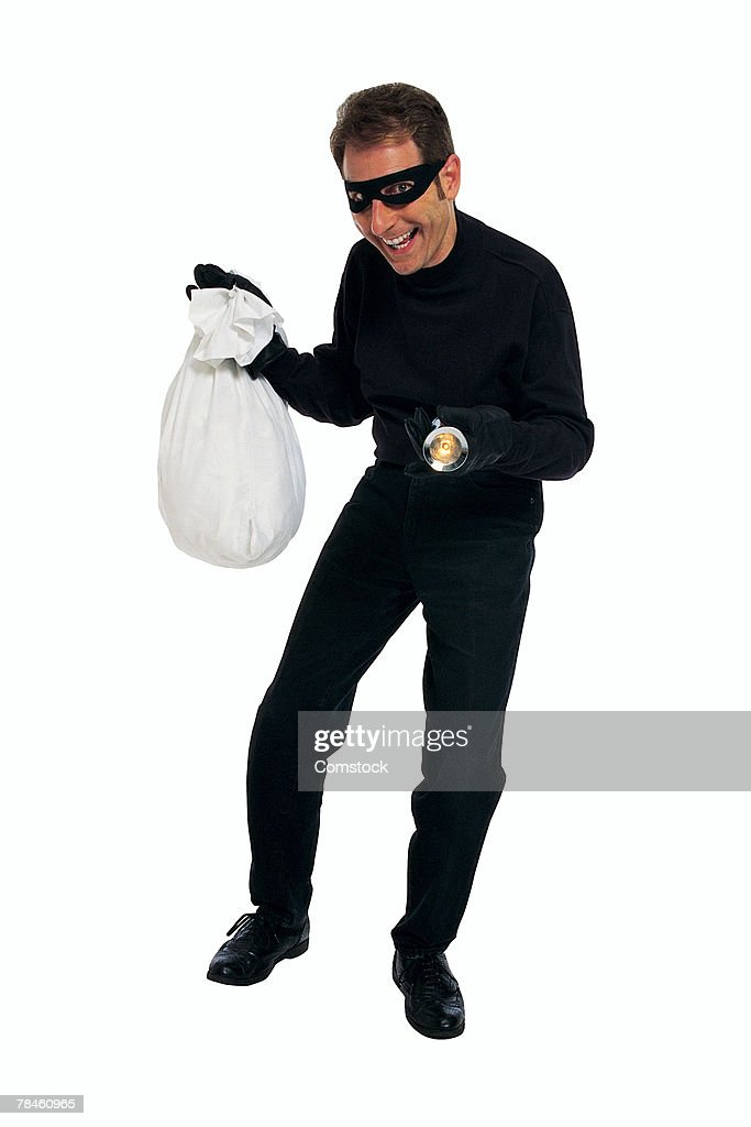 Smiling thief posing with bag