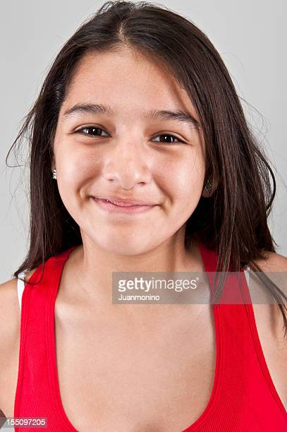 Smiling thirteen years old hispanic girl