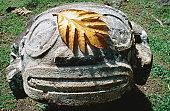 Smiling Tiki and breadfruit leaf, Lipona archeological site.