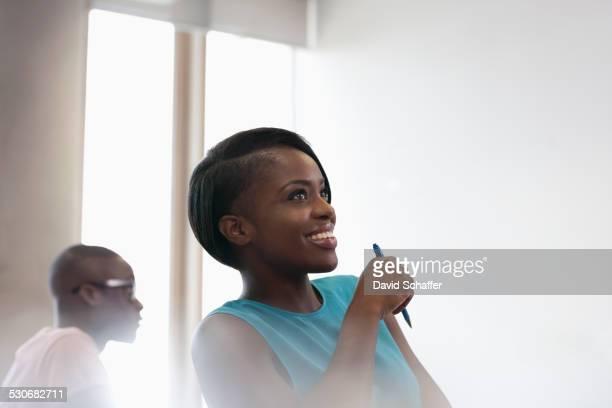 Smiling university student in blue top at seminar