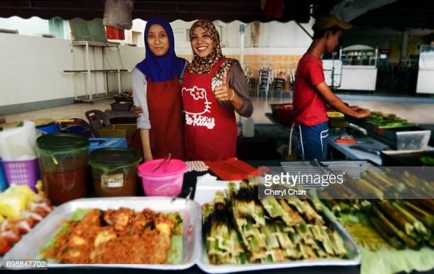 Smiling vendors at Ramadan Bazaar