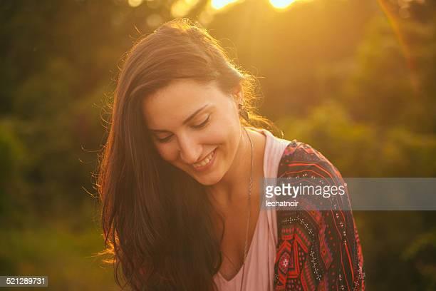 Smiling vintage toned portrait of a young brunette