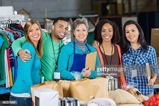 Smiling volunteers at community food bank