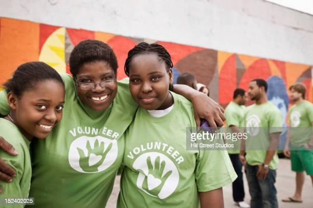 Smiling volunteers hugging